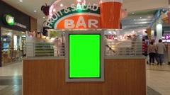 Green billboard for your in front of fruit bar Stock Footage