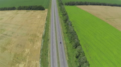 Green and yellow fields and highway. Aerial top view Stock Footage