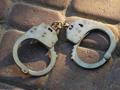 Handcuffs taken closeup. Stock Photos