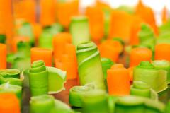 Twisted slices of carrot and zucchini Stock Photos