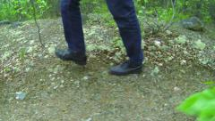 Man walks along the forest path. northern forest Stock Footage