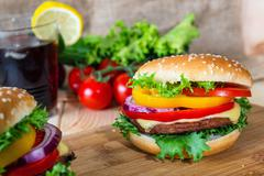 Hamburger and drink with slice of lemon Stock Photos