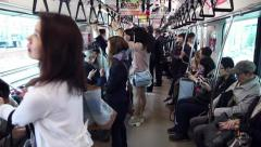 Japanese people, commuters, tourists traveling, train, Tokyo, Japan 2of2 Stock Footage