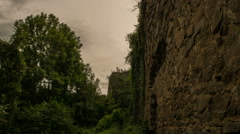 abandoned castle covered in ivy camera tracking forward time lapse - stock footage