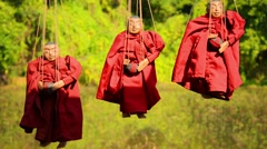 Marionettes - images of buddhist monks. inle lake, myanmar Stock Footage