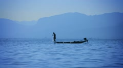 Fisherman catching fish using the network. view from the floating fishing boa Stock Footage