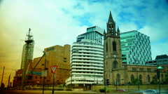 Church of Our Lady and Saint Nicholas amongst New High Rise Modern Apartments, Stock Footage