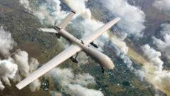 an armed reaper drone in flight - stock footage
