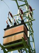 high voltage transformer on metal pylon - stock photo
