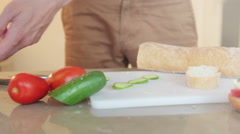 Making a tzatziki and cucumber sandwich Stock Footage