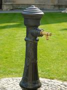 Metal drinking fountain with brass tap Stock Photos