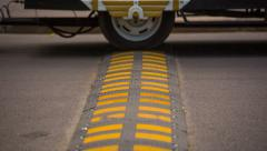 Wheels and Speed Bump on the Road. HD 1080p. Stock Footage
