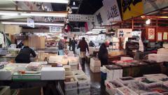 Seafood shops people Tsukiji fish market Tokyo Japan Asia Stock Footage