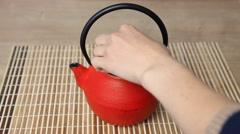 Housewife making tea Stock Footage