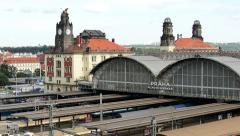 Main train station exterior - passing cars in the background - city Stock Footage