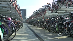 A massive bicycle parking area beside Nijmegen railway station, Netherlands. - stock footage