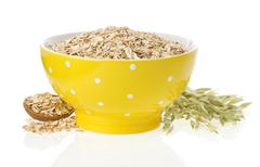 Stock Photo of oat flake in bowl and ears on white