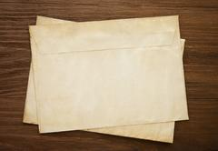 Old postal envelope on wood Stock Photos