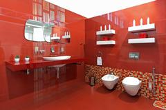 Modern bathroom with red ceramic walls and contemporary fixtures Kuvituskuvat