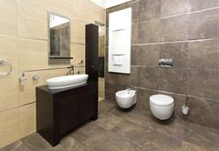 Modern bathroom interior with marble tiles and contemporary fixtures Kuvituskuvat