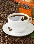 cup of coffee with beans on sack background - stock photo