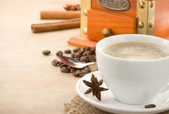 cup of coffee and beans on wood - stock photo