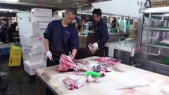 Seafood tuna people Tsukiji fish market Tokyo Japan Asia Stock Footage