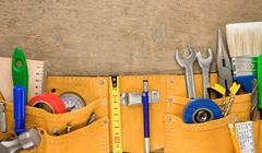 Tools in leathern belt on wood Stock Photos