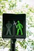 Green traffic light with religious cross Stock Photos