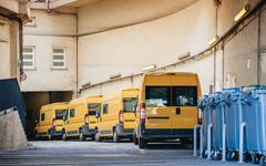 yellow delivery vans trucks distribution - stock photo