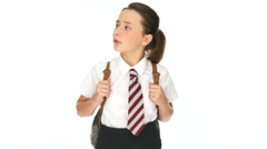 Young school girl standing watching and waiting Stock Footage