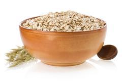 bowl of oat flake on white - stock photo