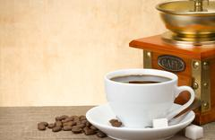 cup of coffee and coffee grinder - stock photo