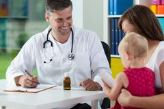 Mother with daughter during medical appointment Stock Photos