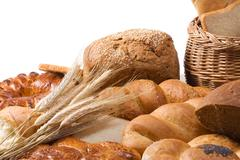 bread, spike, flour and basket isolated on wood - stock photo