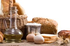 bread, oil, spike and other bakery products on sacking - stock photo