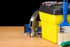 toolbox and construction tools isolated on black - stock photo