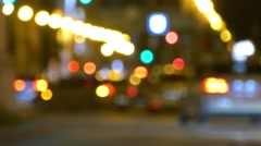 Bokeh Out-Focus night traffic lights in downtown Ludwig street Munich Stock Footage