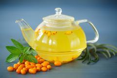 tea with sea buckthorn - stock photo