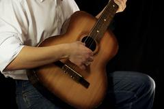 Guitar at black background Stock Photos