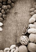 variety of nuts on wood - stock photo