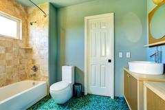 bathroom interior in light blue with tile wall trim - stock photo