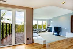 house interior. living room and walkout deck - stock photo