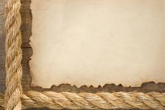 Ropes on old vintage ancient paper Kuvituskuvat