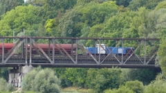 Time Lapse 4K FHD Freight Train transporting Cargo Container on old metal bridge Stock Footage