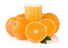 orange juice in glass and slices isolated on white - stock photo
