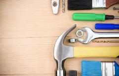 set of tools on wood board - stock photo
