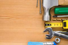 Set of tools on wood background Stock Photos