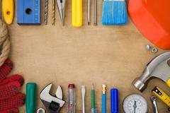 set of tools on wood background - stock photo