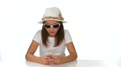 Chic young teenager reading a sms on her mobile Stock Footage